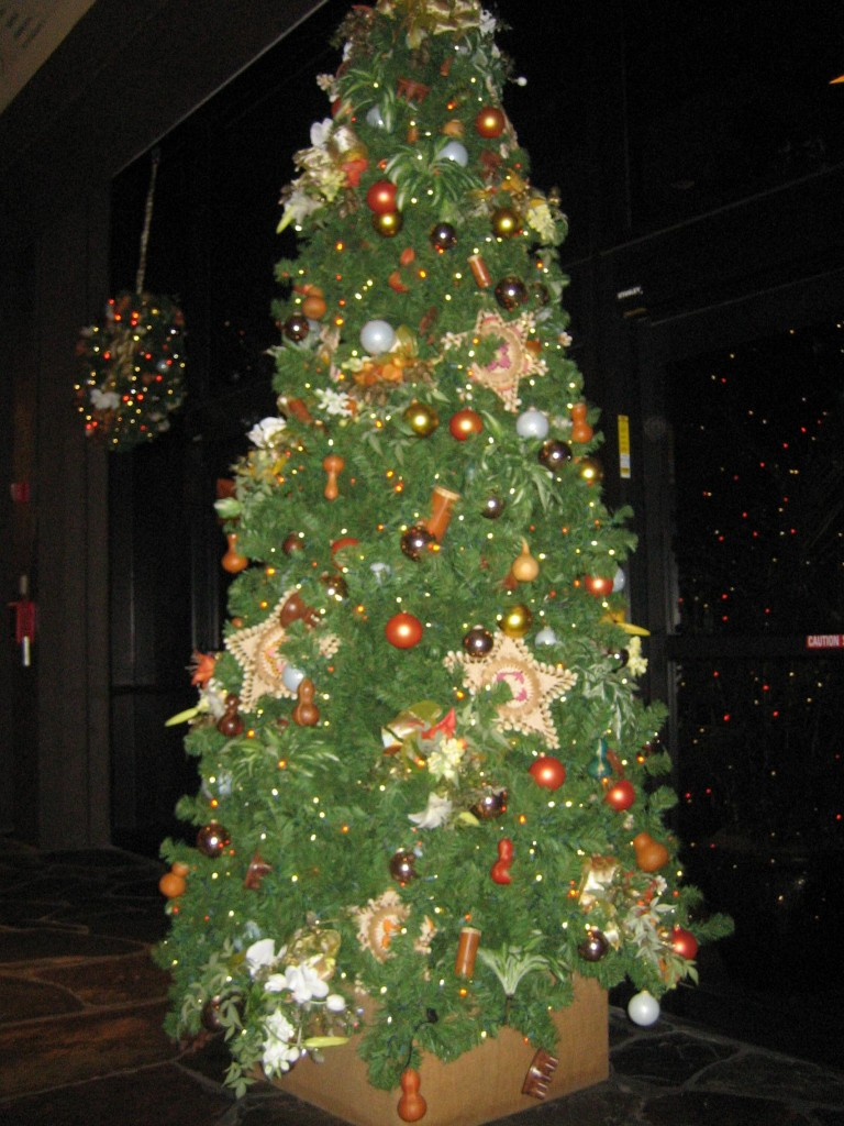 the trees and wreaths are decorated with all things green and bright from natural foliage