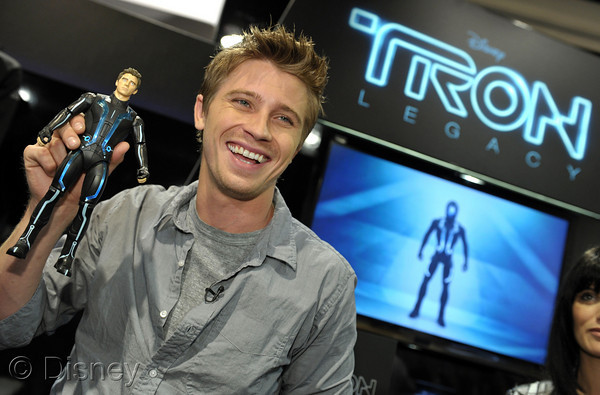 At Comic-Con San Diego 2010 actor Garrett Hedlund (who plays lead character Sam Flynn in Disney's TRON: Legacy in theaters this December) is presented with a custom Sam Flynn action figure from Disney's and Spinmaster's new TRON: Legacy toy line releasing this October. (Photo by John Shearer/Getty Images for Disney)