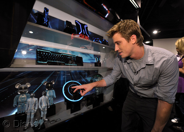 "SAN DIEGO - JULY 23: Actor Garrett Hedlund visits Disney's ""Tron: Legacy"" booth during Comic-Con 2010 at San Diego Convention Center on July 23, 2010 in San Diego, California. (Photo by John Shearer/Getty Images for Disney)"