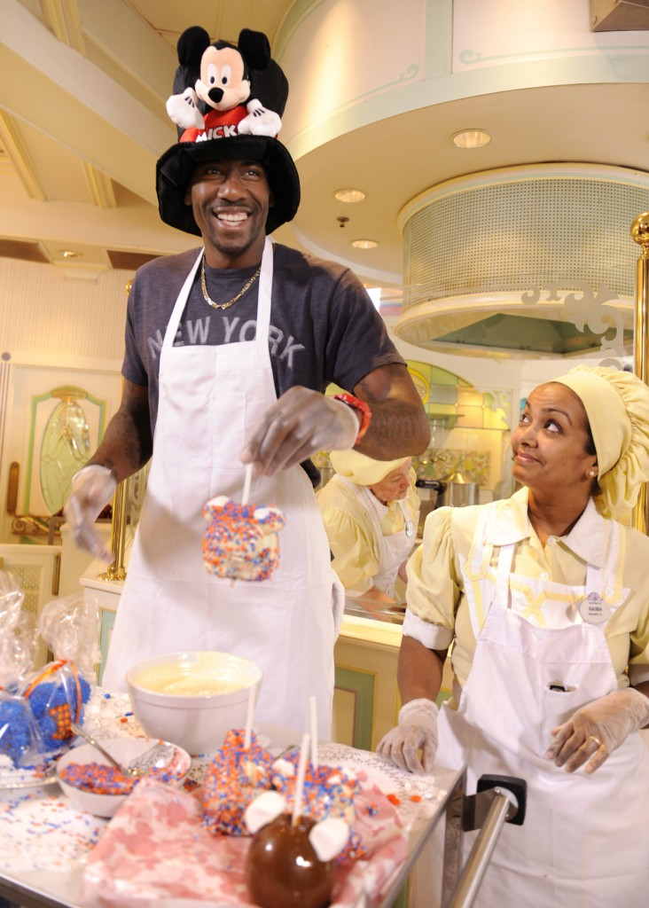 New York Knicks Power Forward Amar'e Stoudemire Prepares Mickey Mouse Candied Apples at the Magic Kingdom