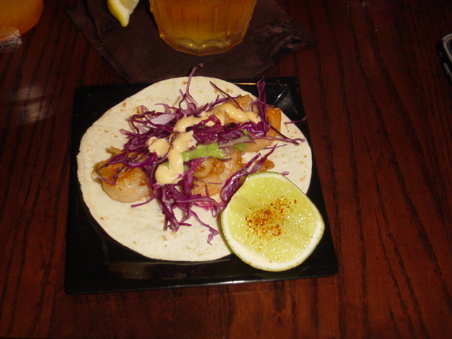 Tacos de Camarones - Fried shrimp, chipotle-lime aioli, cabbage, lime and salsa verde, all served over flour tortillas 22.95