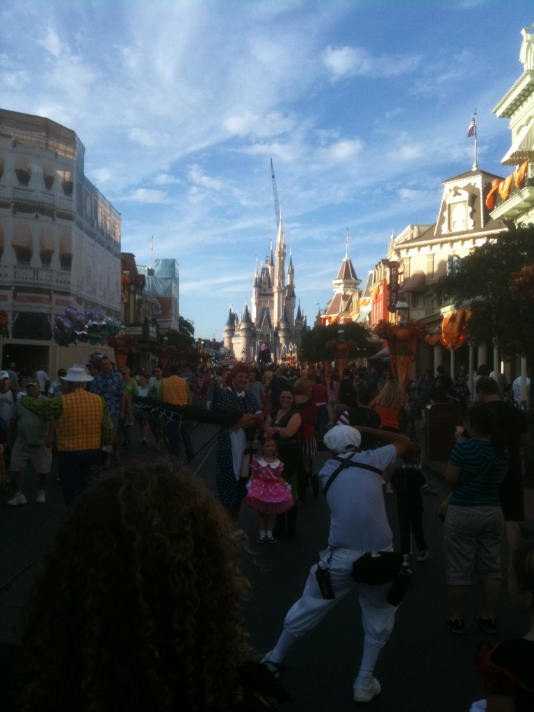 Costumed guests and decorations on Main Street USA