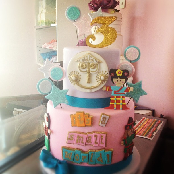 Custom Disney it's a small world layer cake