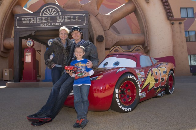 NASCAR Driver Kurt Busch Poses with Piston Cup Driver Lightning McQueen