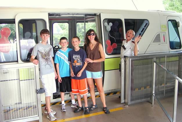 Disney Photobomb Friday – Monorail Driver is Ready to Catch That Disney Popcorn in His Mouth