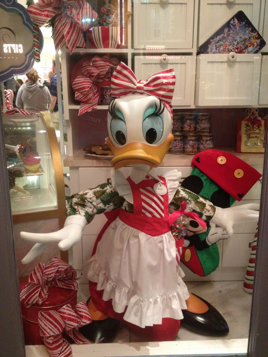 disney magic kingdom mickey's very merry christmas party confectionary window daisy duck