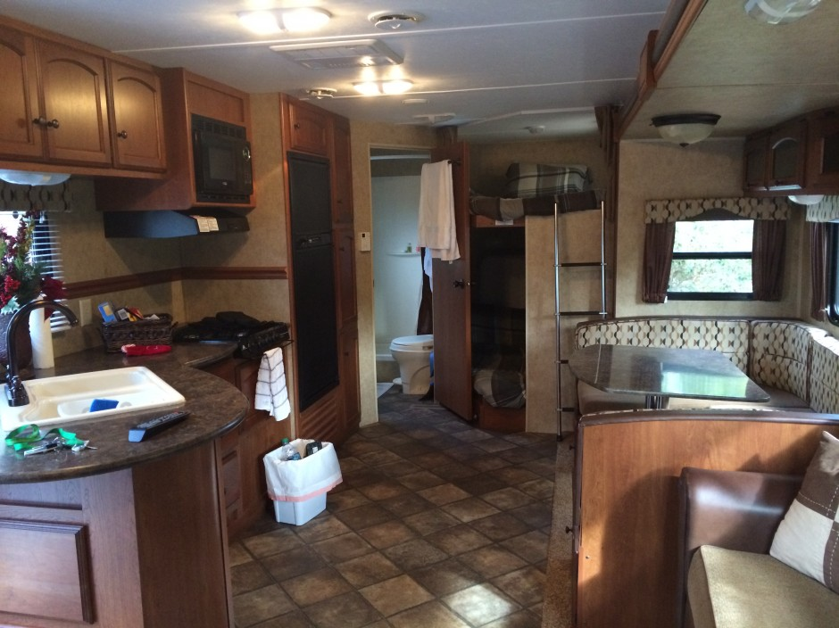 Meacham's RV Disney Fort Wilderness Resort Camper full kitchen and living space
