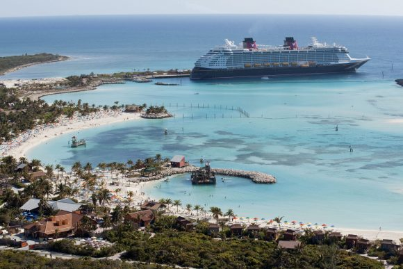 The Disney Dream cruise ship parked at Disney's private Caribbean island, Castaway Cay