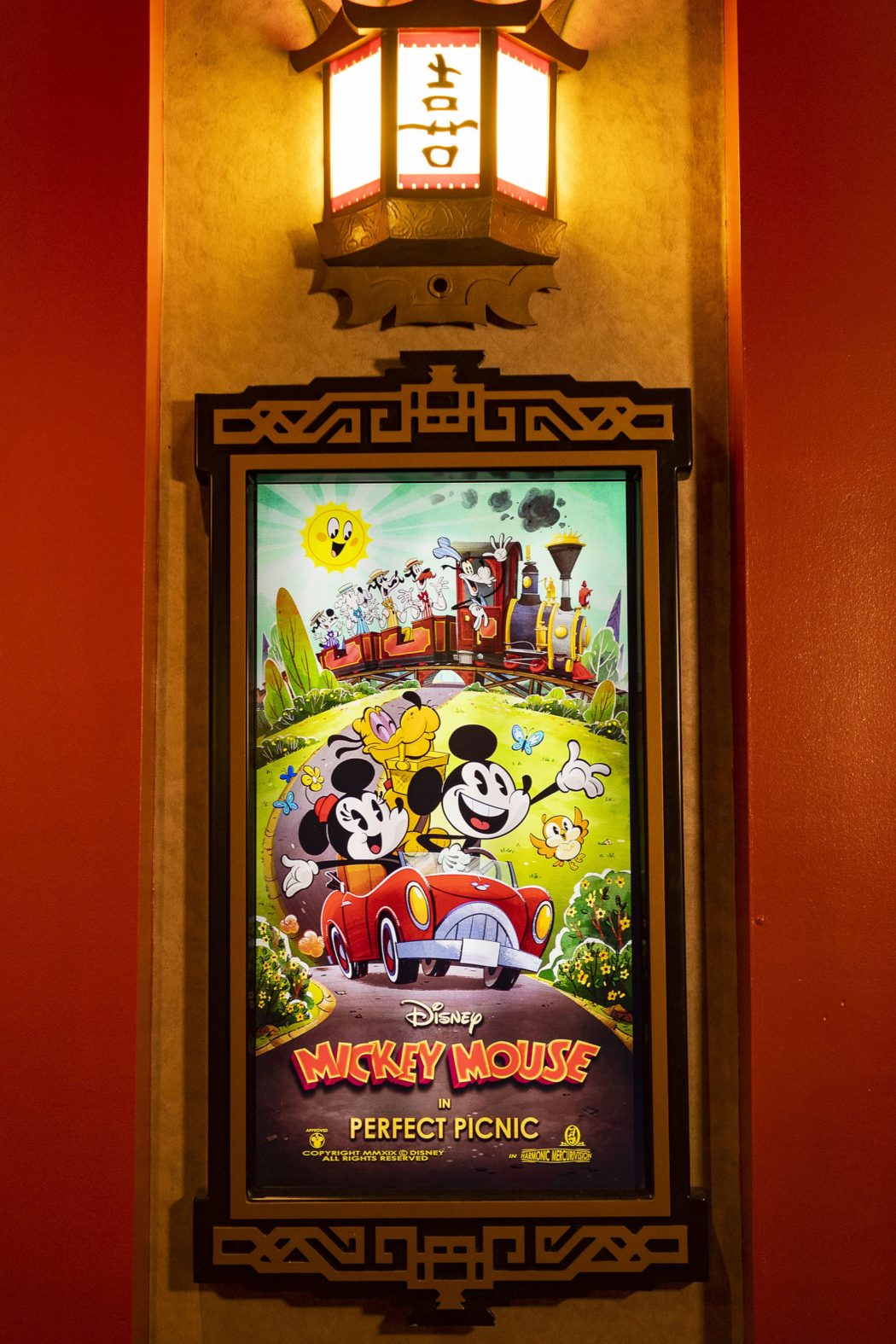 "A poster for ""Perfect Picnic"" is found in the lobby of the Chinese Theater inside Disney's Hollywood Studios at Walt Disney World Resort in Lake Buena Vista, Fla. ""Perfect Picnic"" is a new ""Mickey Mouse"" cartoon short written by Walt Disney Imagineering and produced by Disney Television Animation that serves as guests' entry into the story of Mickey & Minnie's Runaway Railway, the new ride-through attraction opening March 4, 2020, at Disney's Hollywood Studios. (Matt Stroshane, photographer)"